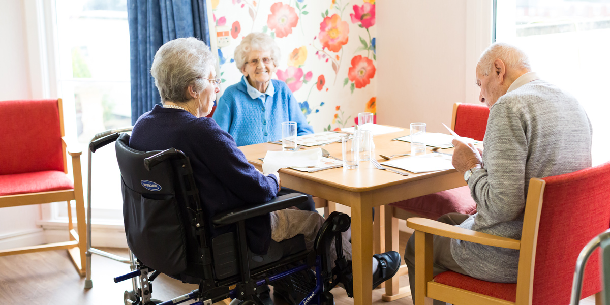 Westlands-care-home-devon-3-residents-in-dining-room