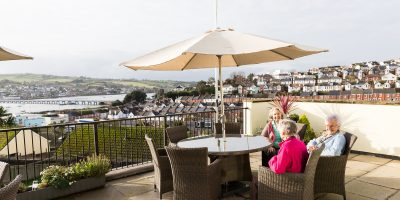 Westlands-care-home-devon-3-residents-on-balcony v2