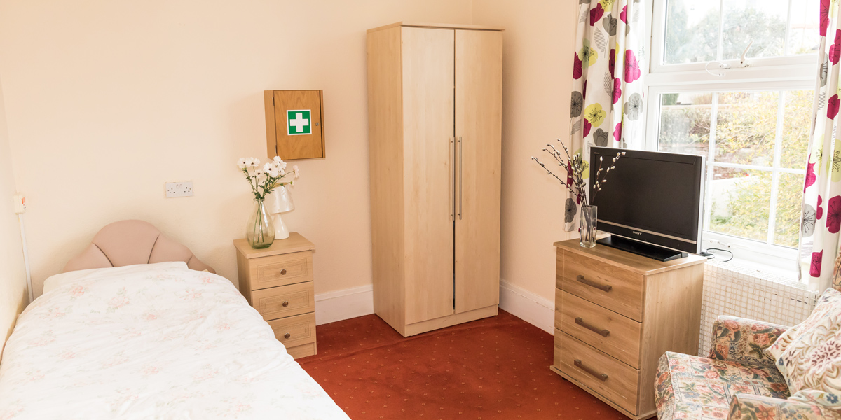 Westlands-care-home-interior-bedroom-with-peach-walls